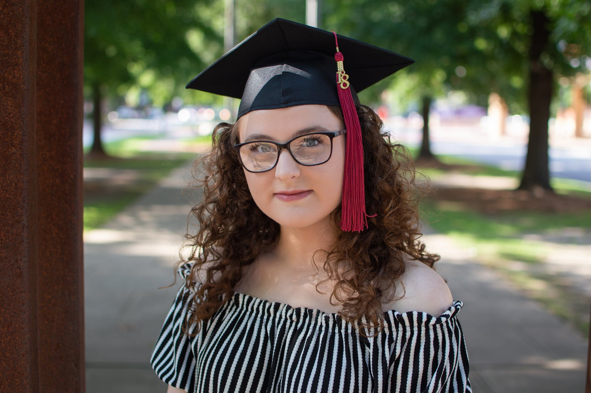 photo of woman wearing square academic cap